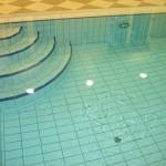 Laipteliai į betoninį baseiną