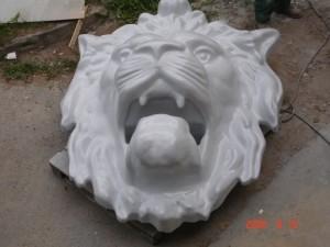 Liūto galvos dekoracija